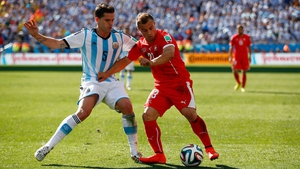 Argentina midfielder Fernando Gago and Shaqiri continued to battle it out throughout regular time