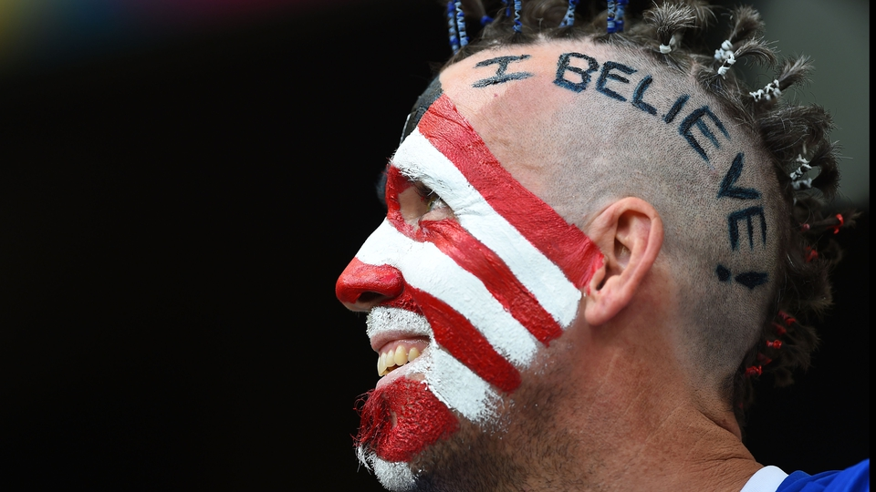 A United States fan gets behind his team