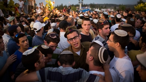 Mourners at the funerals of the three young Israelis today