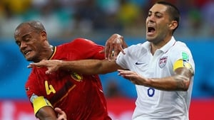 Vincent Kompany and USA's Clint Clint Dempsey clash during Belgium's extra-time win in Salvador