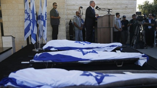 Benjamin Netanyahu (C) eulogises the Israeli teens abducted and killed in the occupied West Bank
