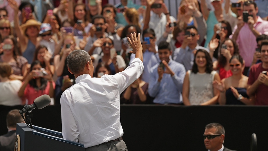 US President Barack Obama waves to crowds gathered at Waterfront Park, Washington DC