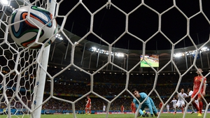 US midfielder Julian Green scores past Belgium's Thibaut Courtois during extra time in the team's World Cup match