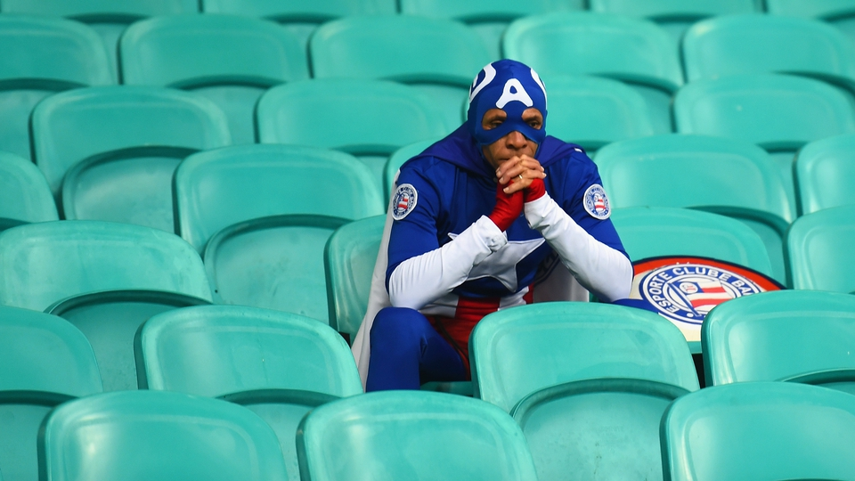 A dejected USA fan after his team's World Cup exit to Belgium