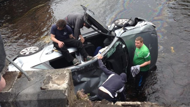 Locals try to help after the car crashes into the river