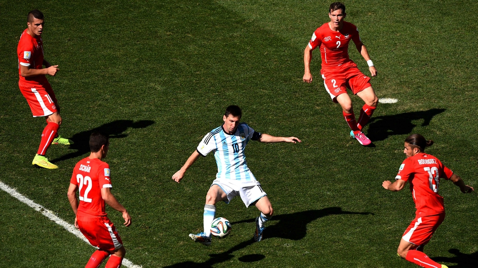 Lionel Messi of Argentina controls the ball against Josip Drmic, Fabian Schar, Stephan Lichtsteiner and Ricardo Rodriguez of Switzerland