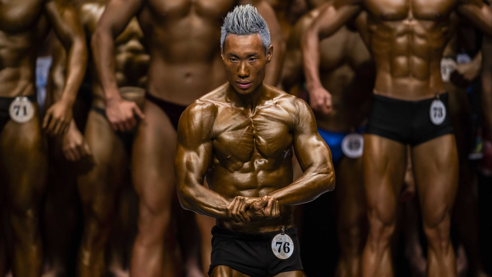 A metallic-looking competitor at the Hong Kong Bodybuilding Championships