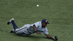Elian Herrera of the Milwaukee Brewers misplays a ball during a Major League Baseball game against the Toronto Blue Jays in Toronto, Canada