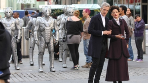New Doctor Who Peter Capaldi with some Cybermen and Michelle Gomez