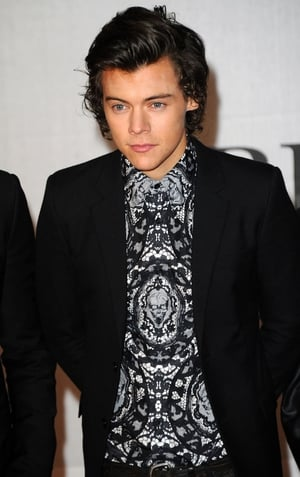 1D's  rep denied rumours that Harry Styles is going solo