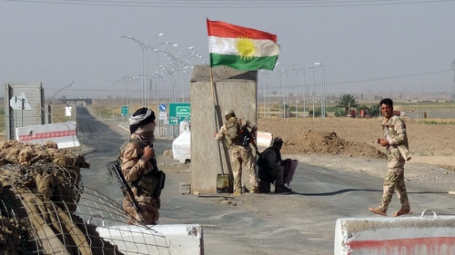 Kurdish Peshmerga forces man a checkpoint on the road leading from Kirkuk to northern Iraqi city of Tikrit