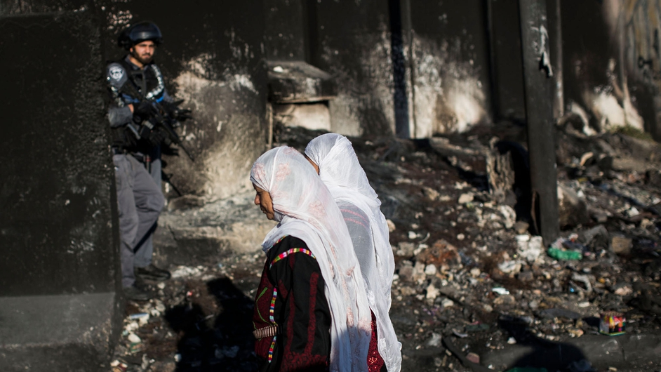Palestinian Muslim worshippers cross the Qalandia checkpoint on their way to Jerusalem near Ramallah, West Bank