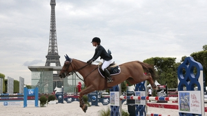 Sevil Sabanci competes with her horse in the Rinck prize of the 'Paris Eiffel Jumping' event at the Champs de Mars in Paris, near the Eiffel tower