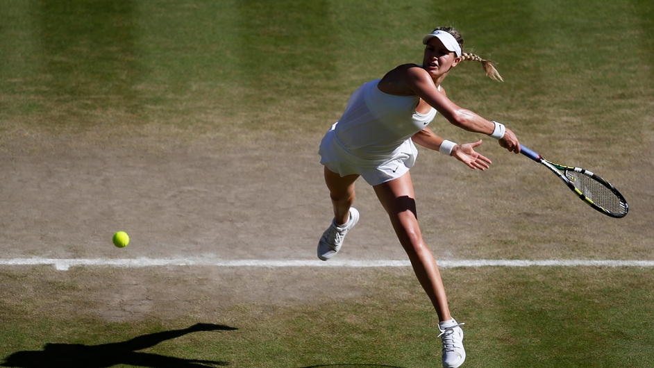 Eugenie Bouchard of Canada returns to Simona Halep of Romania in their semi final match during the Wimbledon Championships