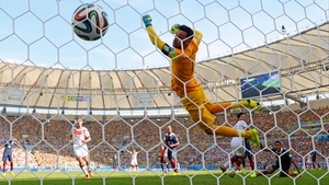 Hugo Lloris is unable to stop Mats Hummels header as Germany take an early lead
