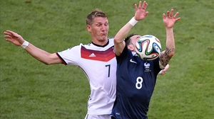 The 6'0 Bastian Schweinsteiger grapples with 5'1 Mathieu Valbuena