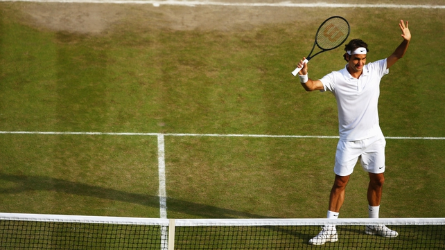 Roger Federer celebrates after beating Milos Raonic