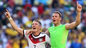 Bastian Schweinsteiger and Manuel Neuer (R) celebrate