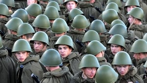 Belarus troops dressed as Soviet Red Army soldiers of the World War II-era stand in central Minsk