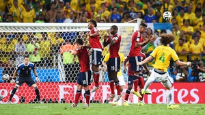 David Luiz  curls a beautiful free-kick into the top corner of the Colombian net