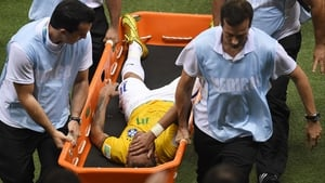 Brazil's star forward Neymar is carried off on a stretcher