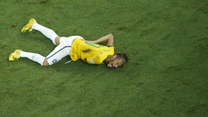 Brazil's talisman Neymar down and out of the World Cup with a fractured vertebra