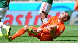 Arjen Robben reacts to a tackle during the Netherlands v Mexico game