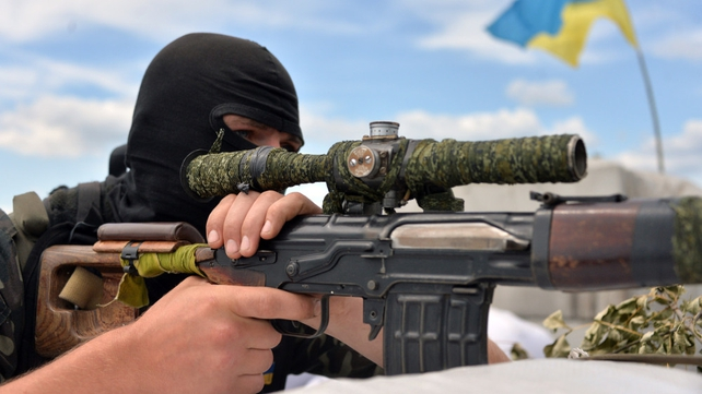 A Ukrainian forces serviceman guards their position at the check-point near Slaviansk