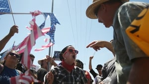 Demonstrators clash at a rally in Murrieta, California over the number of undocumented migrants arriving into the US