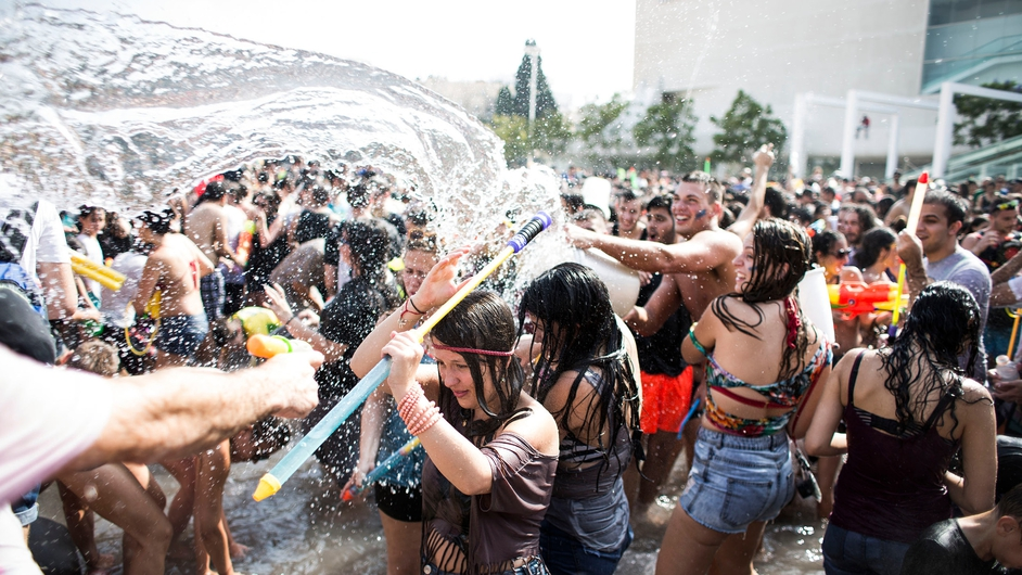 Hundreds of people take part in the annual Tel Aviv Water War fight at Habima Square