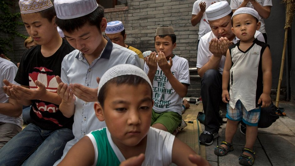 Chinese Muslims of the Hui ethnic minority pray at the Imam's Tombs at the historic Niujie Mosque