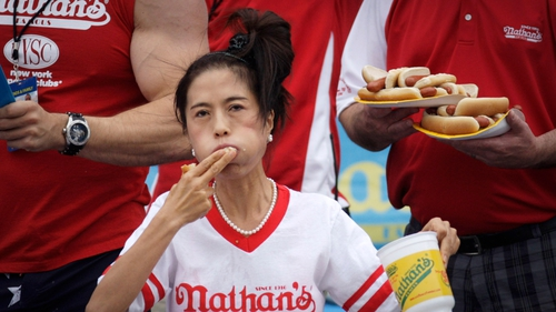 Juliet Lee competes in the women's division of the Nathan's Famous Hot Dog Eating Contest at Coney Island, New York