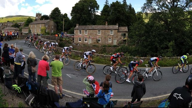 The Peloton passing through the village of Muker, Yorkshire