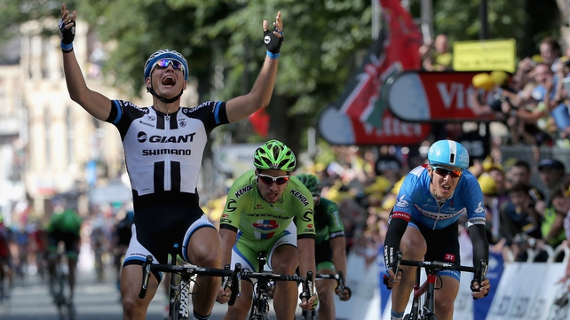 Marcel Kittel of Germany raises his arms as he wins the opening Tour de France stage in Yorkshire