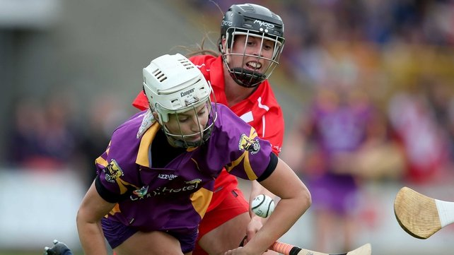 Wexford goalkeeper Mags Darcy with Orla Cotter of Cork battle for possession