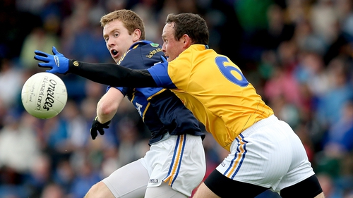 Tipperary's Brian Fox (L) does battle with Enda Williams of Longford
