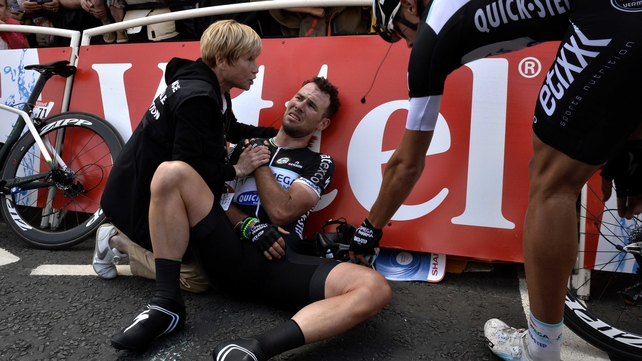 Mark Cavendish receives medical assistance after his fall