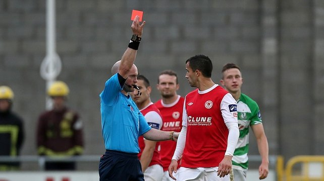 Former Ireland player Keith Fahey receives his marching orders from referee Pádraig Sutton
