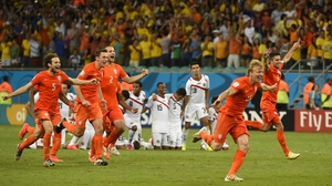 The Netherlands celebrated escaping their first World Cup penalty shootout with a score of 0(4)-0(3). They will now face Argentina in the semi-finals on 9 July