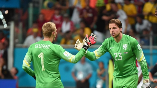Jasper Cillessenshakes hands with Tim Krul as the remarkable substitution was made
