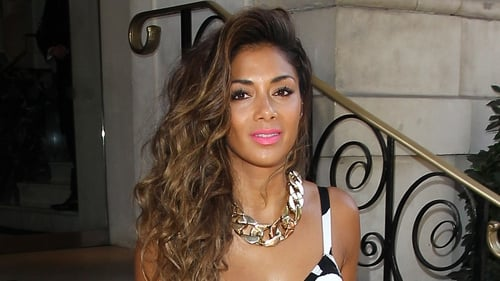 "Scherzinger - ""I would take them home to Hawaii and my family would be like, 'What are they saying?'"""