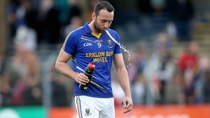 Wicklow's Anthony McLoughlin tries to re-hydrate at the end of the qualifier against Sligo
