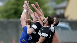 Conor McGraynor of Wicklow is crowded out by Sligo players during their qualifier