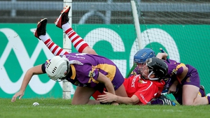 With little quarter given: Wexford's goalkeeper Mags Darcy and Josie Dwyer battle with Gemma O'Connor of Cork