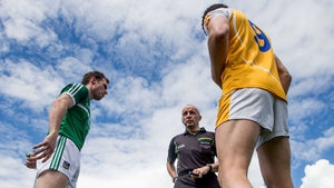 Limerick's Seánie Buckley and Niall McKeever of Antrim at the coin toss with referee Martin Higgins in Saturday's first game