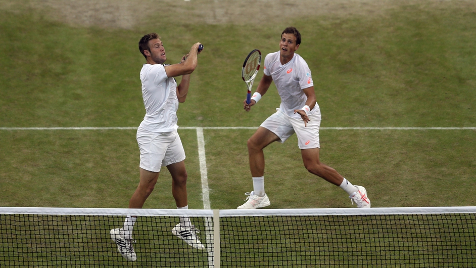 Jack Sock of the United States (l) and Vasek Pospisil of Canada during the Doubles Final at Wimbledon