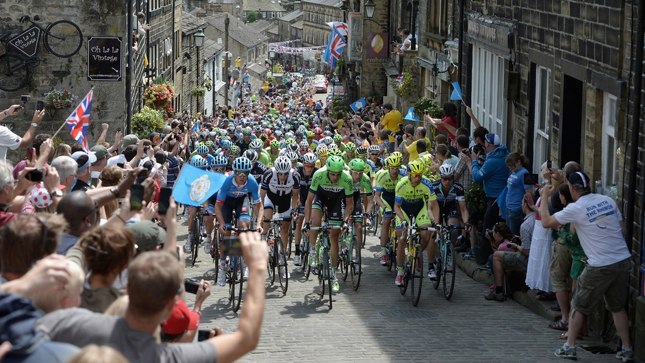 The Peloton rides up Haworth High Street during Stage Two of the Tour de France in England