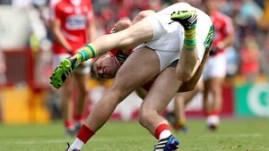 It was a tough, bruising encounter -  here Kerry's Paul Murphy and Paul Kerrigan of Cork clashed off the ball