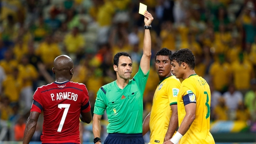 Thiago Silva is shown a yellow card against Colombia
