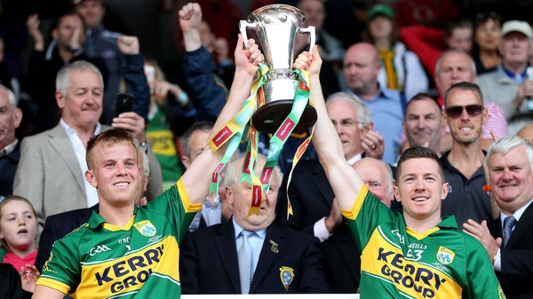 Kerry's Fionn Fitzgerald and Kieran O'Leary lift the cup